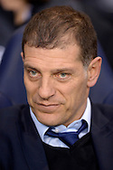 West Ham United manager Slaven Bilic looks on from the dugout before k/o. Barclays Premier league match, Tottenham Hotspur v West Ham Utd at White Hart Lane in London on Sunday 22nd November 2015.<br /> pic by John Patrick Fletcher, Andrew Orchard sports photography.