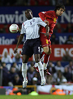 Photo: Paul Thomas.<br /> England v Macedonia. UEFA European Championships 2008 Qualifying. 07/10/2006.<br /> <br /> Man of the month Ledley King (L) of England wins the ball ahead of Darko Tasevski.
