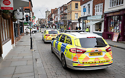 © Licensed to London News Pictures. 04/03/2019. Salisbury, UK. Police vehicles are seen on Salisbury High Street on the first anniversary of the poisoning of former Russian spy Sergei Skripal and his daughter Yulia in March 2018. They both survived the nerve agent attack but a resident of nearby Amesbury, Dawn Sturgess, died in June 2018 after coming in contact with the poison. Two Russians have been named in connection with the attack. Photo credit: Peter Macdiarmid/LNP
