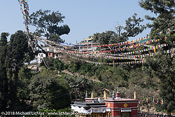 Prayer flags hang over Swayambhunath, also known as the Monkey Temple, in the Kathmandu Valley. This complex that dates back to the 5th century its revered by both Buddhists and Hindus and includes a large stupa as well as a group of shrines and temples that we visited during our Himalayan Heroes adventure, Nepal. Monday, November 5, 2018. Photography ©2018 Michael Lichter.