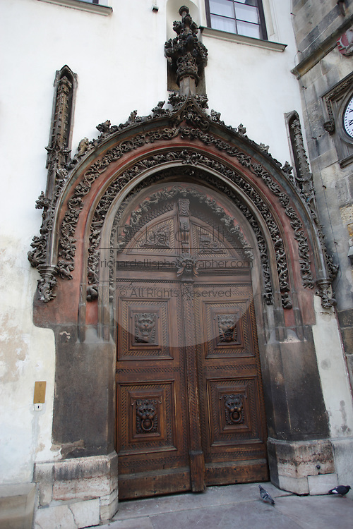 Gothic door used as the main entrance to the town hall and Tower in Prague, Czech Republic. The door was carved by Matthias Rejsek.