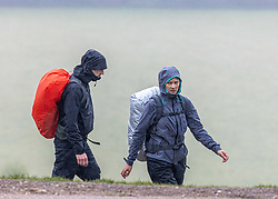 Licensed to London News Pictures. 08/05/2021. Dorking, UK. Hikers brave the wind and rain on Box Hill, Surrey, this morning as more rain hits the South East as its revealed that May had the coldest Bank Holiday on record. However, weather forecasters predict beach and bbq weather tomorrow (Sunday) with sunshine and temperatures hitting over 20c as the miserable May weather finally starts to warm up. Photo credit: Alex Lentati/LNP