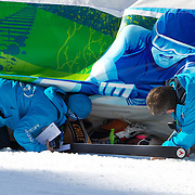 Winter Olympics, Vancouver, 2010.A funny moment when Noelle Barahona, Chile, finishing in the Alpine Skiing Ladies downhill at Whistler Creekside, slipped right under the protective barrier and had to be helped out by officials  during the Vancouver  Winter Olympics. 17th February 2010. Photo Tim Clayton