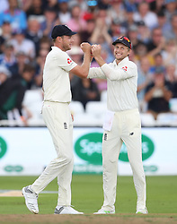 England's Stuart Broad (left) celebrates the wicket of India's Mohammed Shami with teammate Joe Root during day two of the Specsavers Third Test match at Trent Bridge, Nottingham.