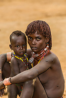 Hamer tribe woman with her baby, Omo Valley, Ethiopia.