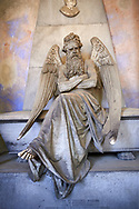 Picture and image of the stone sculpture of an angel sitting on a sarcophagus. Piaggio Tomb sculpted by S Saccomanno 1876. Section A, no 46, The  monumental tombs of the Staglieno Monumental Cemetery, Genoa, Italy .<br /> <br /> Visit our ITALY PHOTO COLLECTION for more   photos of Italy to download or buy as prints https://funkystock.photoshelter.com/gallery-collection/2b-Pictures-Images-of-Italy-Photos-of-Italian-Historic-Landmark-Sites/C0000qxA2zGFjd_k<br /> If you prefer to buy from our ALAMY PHOTO LIBRARY  Collection visit : https://www.alamy.com/portfolio/paul-williams-funkystock/camposanto-di-staglieno-cemetery-genoa.html