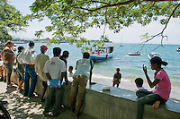 A group waits for their boat to be ready for a trip across the Wetar Strait from Dili to Atauro Island, Timor-Leste (East Timor)
