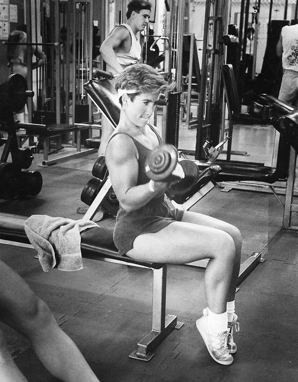©1986 Amateur bodybuilder at small local gym, Austin, Texas.