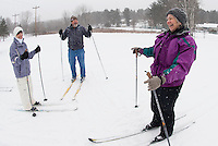 A perfect winter's day with the snow gently falling Debbie Birch, Bob Bolduc and Lainie Rosato head out onto the cross country trails at Bolduc Park for their weekly skiing lesson offered by the Gilford Parks and Recreation department Saturday morning.  (Karen Bobotas/for the Laconia Daily Sun)