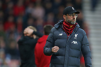 Football - 2019 / 2020 Premier League - AFC Bournemouth vs. Liverpool<br /> <br /> Liverpool Manager Jurgen Klopp clenches his fist in celebration of the first goal as Bournemouth's Manager Eddie Howe hold his head in his hands at the Vitality Stadium (Dean Court) Bournemouth <br /> <br /> COLORSPORT/SHAUN BOGGUST