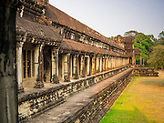 """13 MARCH 2015 - SIEM REAP, SIEM REAP, CAMBODIA: The north wall of Angkor Wat.  The area known as """"Angkor Wat"""" is a sprawling collection of archeological ruins and temples. The area was developed by ancient Khmer (Cambodian) Kings starting as early as 1150 CE and renovated and expanded around 1180CE by Jayavarman VII. Angkor Wat is now considered the seventh wonder of the world and is Cambodia's most important tourist attraction.   PHOTO BY JACK KURTZ"""