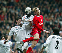 Liverpool's Sami Hyypia and Middlesbrough Chris Riggott (l) and Michael Ricketts (r) during the Premiership  match at Anfield, Liverpool, Saturday, February 8th, 2003.<br /><br />Pic by David Rawcliffe/Propaganda<br /><br />Any problems call David Rawcliffe on +44(0)7973 14 2020 or email david@propaganda-photo.com - http://www.propaganda-photo.com