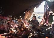 Men and women having breakfast in the morning in their nomadic tent on the edge of the Lut Desert.
