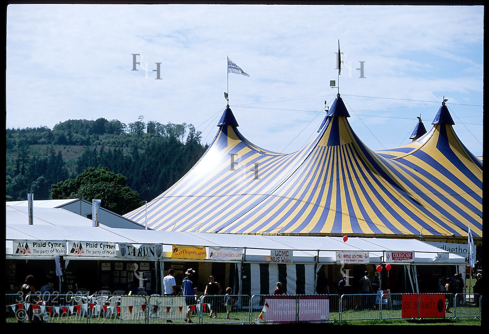 Spires of big-top tent loom over fairgrounds of the annual National Eisteddfod cultural festival; Meifod, Wales.