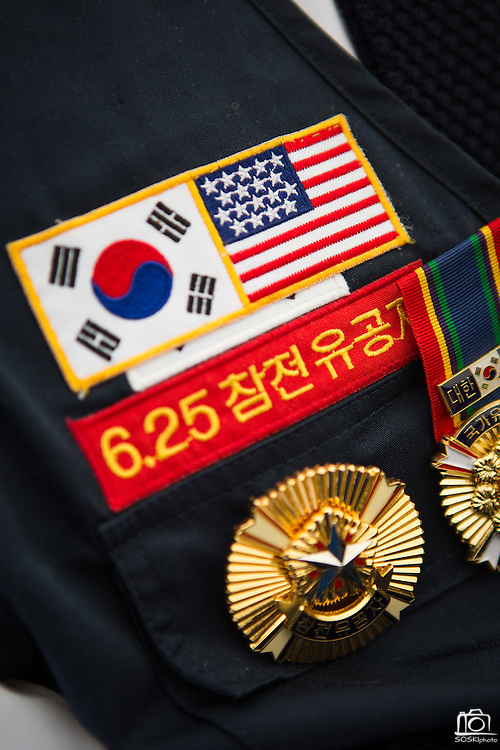 Service members of the United States Army wear their Korean War badge-decorated uniforms during the Milpitas Memorial Day Ceremony at Veterans Memorial Flag Plaza in Milpitas, California, on May 27, 2013. (Stan Olszewski/SOSKIphoto)