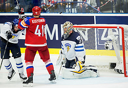 Nikolai Kulyomin of Russia vs Tuukka Mantyla of Finland and Pekka Rinne of Finland during Ice Hockey match between Finland and Russia at Day 12 in Group B of 2015 IIHF World Championship, on May 12, 2015 in CEZ Arena, Ostrava, Czech Republic. Photo by Vid Ponikvar / Sportida