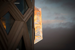 © Licensed to London News Pictures. File picture taken 12/09/2016.Sunrise reflecting into a John Lewis sign in Leeds. John Lewis has confirmed another eight stores will close permanently putting 1,465 jobs at risk. The retail giant has announced it plans to close shops in Kent, Yorkshire, Aberdeen, Cheshire, Hampshire and Northamptonshire. In January the group recorded its first loss in its 157-year history, after announcing that eight stores were closing last July. Photo credit: Andrew McCaren/LNP