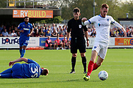 Portsmouth midfielder Tom Naylor (7) winning ball from AFC Wimbledon striker Joe Pigott (39) during the EFL Sky Bet League 1 match between AFC Wimbledon and Portsmouth at the Cherry Red Records Stadium, Kingston, England on 13 October 2018.