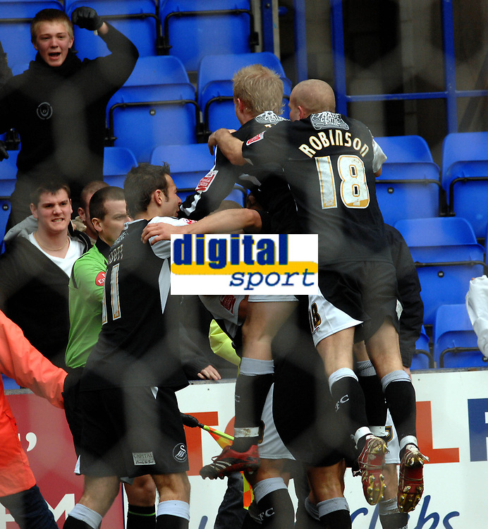 Photo: Paul Greenwood.<br />Tranmere Rovers v Swansea City. Coca Cola League 1. 10/03/2007.<br />Swansea city players celebrate their second goal in front of Tranmere fans earning scorer Lee Trundle the first of his two yellow cards.