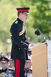 © Licensed to London News Pictures. 11/06/2015. National Memorial Arboretum, Alrewas, Staffordshire, UK. The service to mark the Rededication of the Bastion Memorial. The memorial was begun in Helmand Province in 2006, deconstructed in 2014 and now replicated at the National Memorial Arboretum in Staffordshire. Around two thousand people took part in the service including HRH Prince Harry, the Prime Minister David Cameron and senior members of the Armed Forces. Pictured, HRH PRINCE HARRY giving his speech. Photo credit : Dave Warren/LNP
