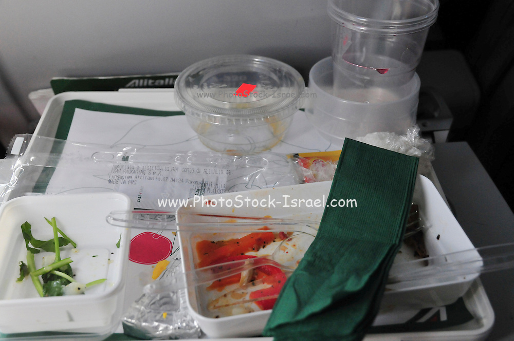 Food try served to economy class passengers during an international flight. After the meal