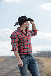 All American cowboy on a ranch looking off