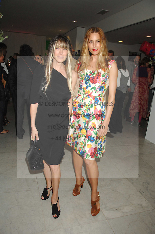 Left to right, GELA TAYLOR and YASMIN LE BON at a reception hosted by Vogue magazine to launch photographer Tim Walker's book 'Pictures' sponsored by Nude, held at The Design Museum, Shad Thames, London SE1 on 8th May 2008.<br /><br />NON EXCLUSIVE - WORLD RIGHTS
