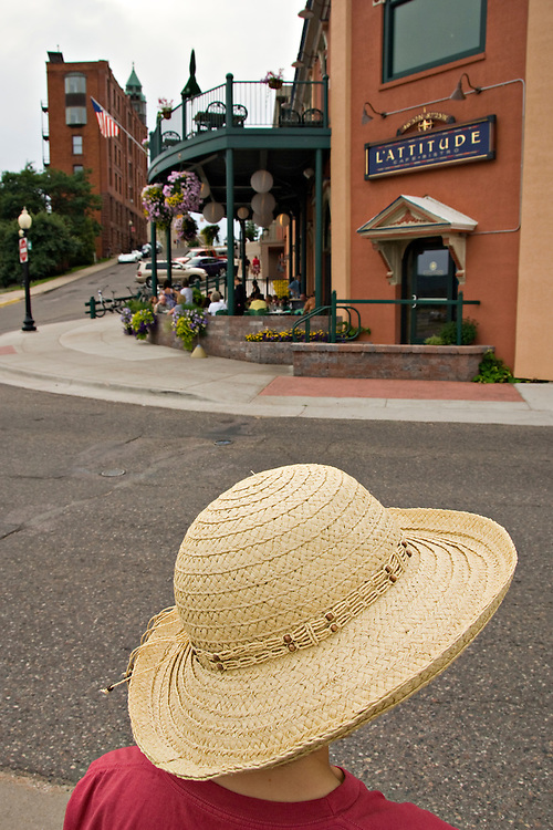 A lady in a sunhat in downtown Marquette Michigan.