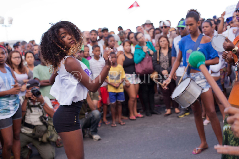 Young Brazilian woman girl dancing Passinho at a protest in Copacabana, Rio de Janiero, in response to the mysterious death of professional dancer Douglas Rafael da Silva Pereira, allegedly at the hands of the Police. The favela Pavao-Pavaozinho that sits in between Copacabana and Ipanema. These protests saw a rare solidarity between the mostly middle class black bloc movement and members of the favela community.