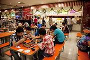 People eating lunch on the canteen food hall floor of the e-plaza digital shopping mall. Zhongguancun or Zhong Guan Cun, is a technology hub in Haidian District, Beijing, China. It is situated in the northwestern part of Beijing city. Zhongguancun is very well known in China, and is often referred to as China's Silicon Valley. This is Beijing's computer district with numerous tech companies offices situated here amongst the many malls which sell electronics and electrons equipment of all kinds. The tech park started as a small office where two decades ago some students from a nearby university decided that computer equipment may be a thing of the future so set up a small company. It has expanded in this time to  cover many square kilometres.