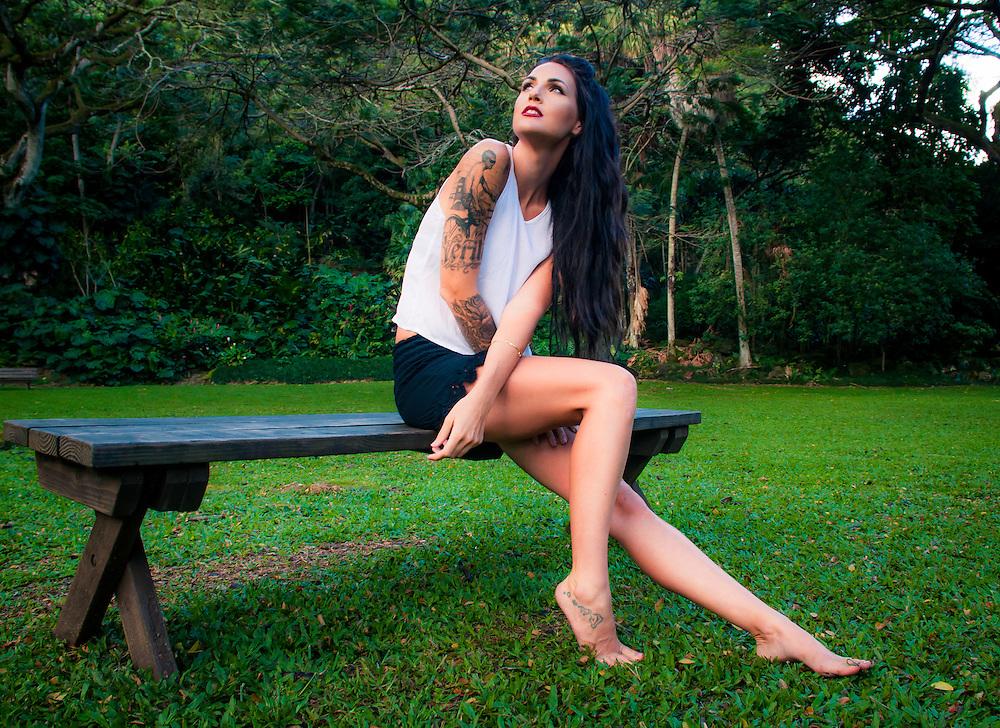 Woman on the grass in Hawaii wearing shirt and shorts by Mila Bikinis. <br /> www.milabikinis.com<br /> Model Jessica Surratt