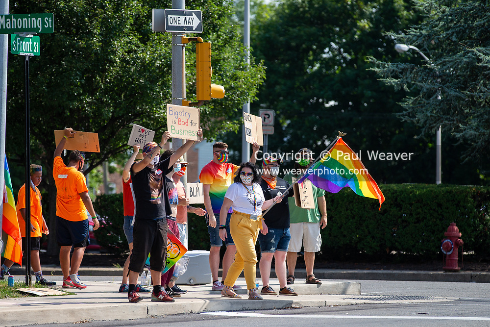 Victoria Mathews, founder of The I Am Alliance waves a pride flage during the Milton Pride Rally in Milton, Pennsylvania on August 8, 2020. The I Am Alliance organized the event to show support for the LGBTQ community. (Photo by Paul Weaver)