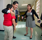 Superintendent Richard Carranza is greeted by 5th grader Matthew Carranza and Maria Garcia during a stop of his Listen & Learn Tour of the district at Memorial Elementary School, September 16, 2016.