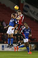 Chris Basham of Sheffield Utd and Jermaine Hylton of Swindon Town during the English League One match at Bramall Lane Stadium, Sheffield. Picture date: December 10th, 2016. Pic Simon Bellis/Sportimage