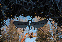 Josh Gibson with Boreal Property Management hangs Christmas lights in the Jackson Town Square on Monday afternoon. The Chamber of Commerce's annual Town Square Lighting Ceremony will be Friday from 5-7:00 p.m. to kick off the holiday season in Jackson Hole.