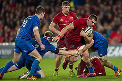 December 30, 2018 - Limerick, Ireland - CJ Stander of Munster tackled by James Tracy of Leinster during the Guinness PRO14 match between Munster Rugby and Leinster Rugby at Thomond Park in Limerick, Ireland on December 29, 2018  (Credit Image: © Andrew Surma/NurPhoto via ZUMA Press)