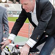NLD/Amsterdam/20120306 - Presentatie olympisch team NUON - NOC-NSF Vattenfall, Gerard Dielessen, algemeen directeur van NOC*NSF op een racefiets