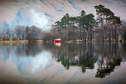 © Licensed to London News Pictures. 06/03/2020.Glenridding UK. A boat reflects into the calm water of Ullswater lake in Cumbria  morning. Photo credit: Andrew McCaren/LNP