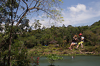 """A zipline or zip line is also known as a death slide, tyrolean traverse or zip wire.  Ziplines work by using pullies suspended on a cable mounted on an incline. The speed is propelled by gravity; travel from top to the bottom of an incline.  This one is called """"Slide for Life"""" at Mambukal Resort in Bacolod, Philippines."""