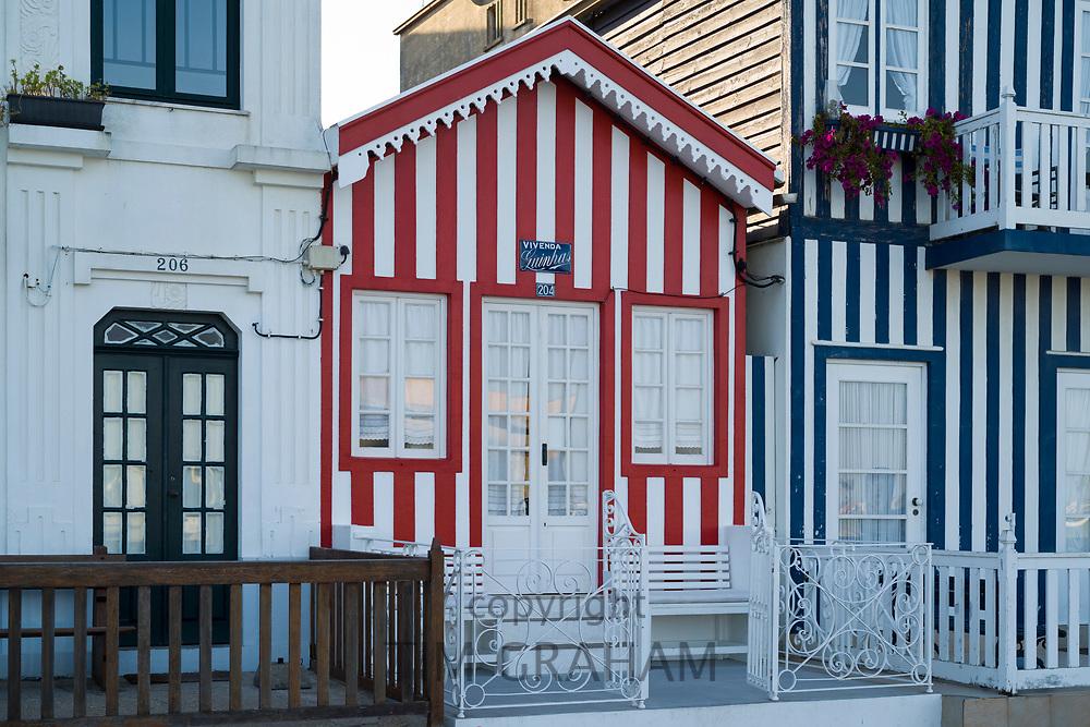 Palheiros striped coloured houses in Costa Nova do Prado a village with many holiday homes near Aveiro,  Portugal