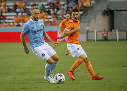 July 18, 2018 - Houston, TX, U.S. - HOUSTON, TX - JULY 18:  Sporting Kansas City forward Johnny Russell (7) keeps the ball away from Houston Dynamo midfielder Tomas Martinez (10) during the US Open Cup Quarterfinal soccer match between Sporting KC and Houston Dynamo on July 18, 2018 at BBVA Compass Stadium in Houston, Texas. (Photo by Leslie Plaza Johnson/Icon Sportswire) (Credit Image: © Leslie Plaza Johnson/Icon SMI via ZUMA Press)
