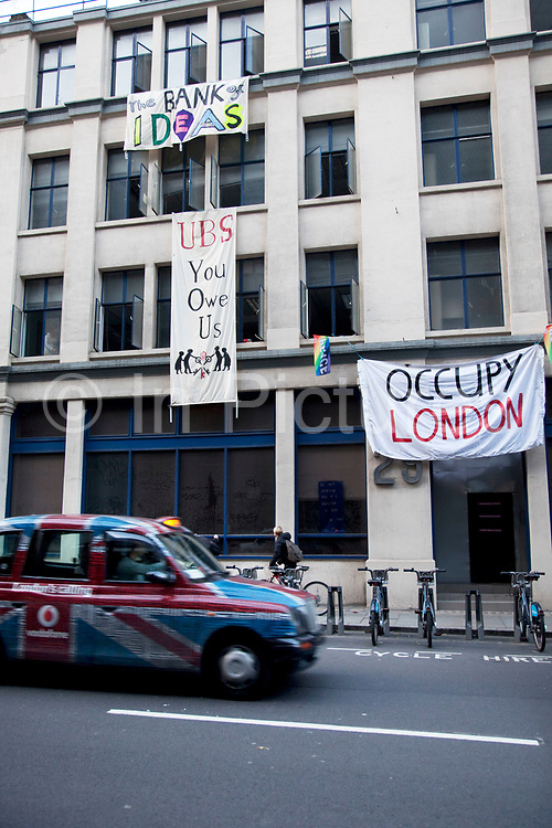 """Occupy London protesters have taken over an empty office block on the edge of The City of London, belonging to the bank UBS. An Occupy London spokesman described the new move as """"public repossession"""". The building will be used for discussion to further ideas about the financial imbalance in society."""