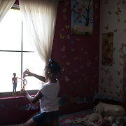Aliyah Randle plays with Barbie and Ken, September 2, 2017, in the bedroom she shares with one of her foster sisters. Aliyah now has the house and family she had hoped for when she was living at the shelter.