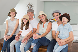 Smiling extended family wearing hats, portrait