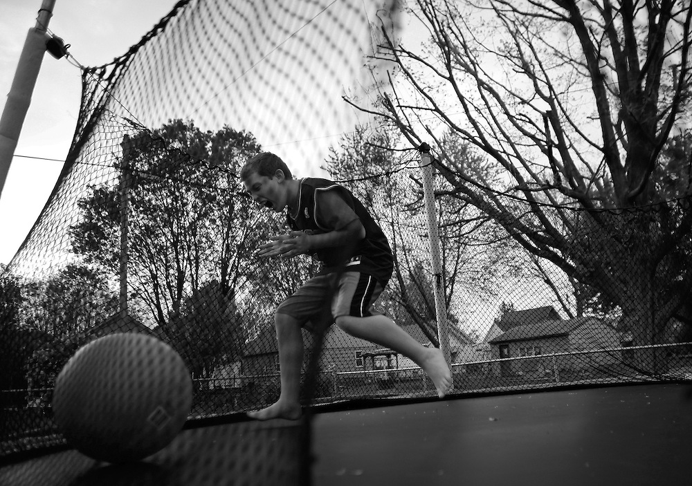 Parker Roos, who suffers from Fragile X, plays on a trampoline in his backyard at his home in Canton, Illinois, April 4, 2012.  REUTERS/Jim Young