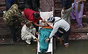 KATHMANDU, NEPAL - APRIL 28: (CHINA OUT) <br /> <br /> People cremate the quake victims on April 28, 2015 in Kathmandu, Nepal. A major 7.8 earthquake hit Kathmandu mid-day on Saturday, and was followed by multiple aftershocks that triggered avalanches on Mt. Everest that buried mountain climbers in their base camps. Many houses, buildings and temples in the capital were destroyed during the earthquake, leaving thousands dead or trapped under the debris as emergency rescue workers attempt to clear debris and find survivors. Regular aftershocks have hampered recovery missions as locals, officials and aid workers attempt to recover bodies from the rubble. <br /> ©Exclusivepix Media