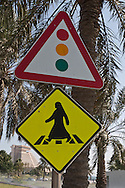 = urban sign with a woman in tchador on The corniche  Doha  Qatar   la corniche  Doha  Qatar