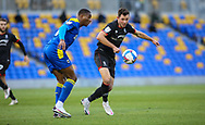 Paul Kalambayi of AFC Wimbledon  and Lincoln City Forward Tom Hopper (9)during the EFL Sky Bet League 1 match between AFC Wimbledon and Lincoln City at Plough Lane, London, United Kingdom on 2 January 2021.