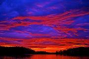 Red sunset over lake - Quebec, Canada.