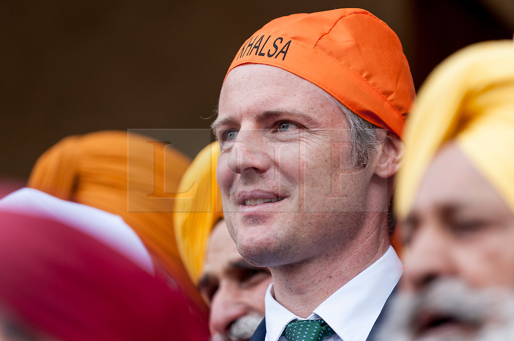 © Licensed to London News Pictures. 10/04/2016. London, UK. Zac Goldsmith MP, Conservative candidate for Mayor of London, visits Gurdwara Sri Guru Singh Sabha temple at the start of the Vaisakhi festival in Southall, west London.  Thousands of Sikhs enjoy the festivital which celebrates the Sikh New Year and harvest festival. Photo credit : Stephen Chung/LNP